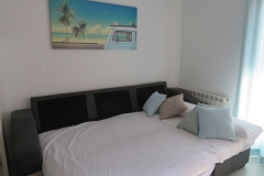 Sofa cama en comedor apartamento I Alcañiz Flat